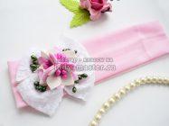 Нежно-розовая детская повязка с бантом